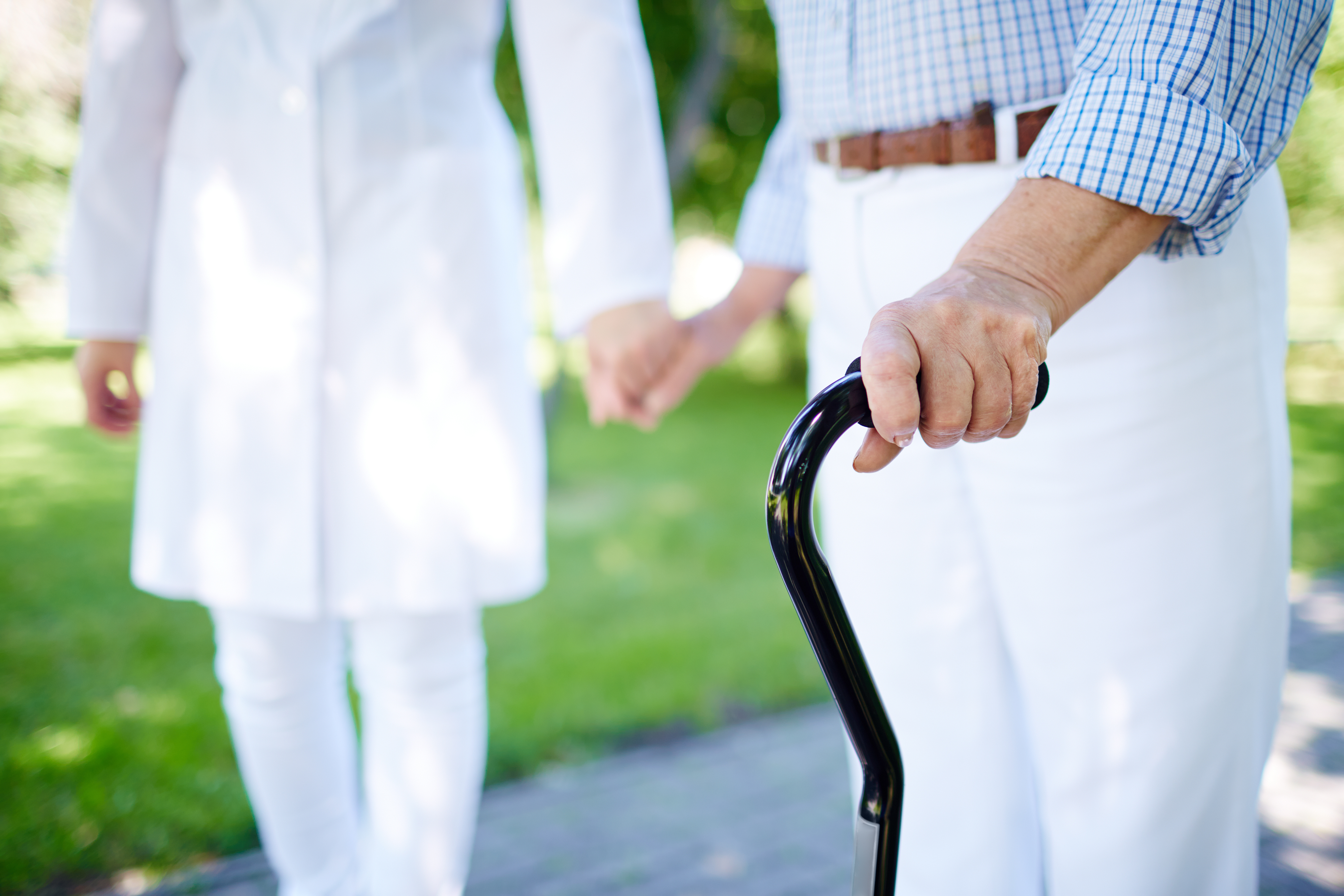 close-up-elderly-woman-with-walking-stick
