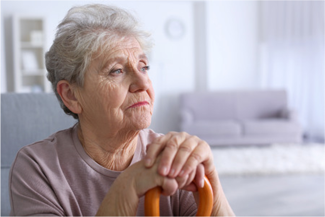 sad older person with cane
